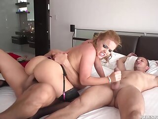 Smoking hot blonde in black stockings and garter belt is getting her daily dose of threesome